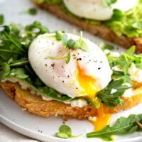 Soft poached egg with runny yolk on toast