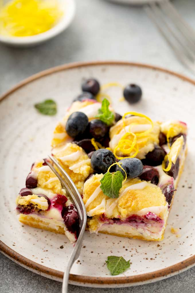 Cheesecake  and streusel blueberry lemon bar on a plate