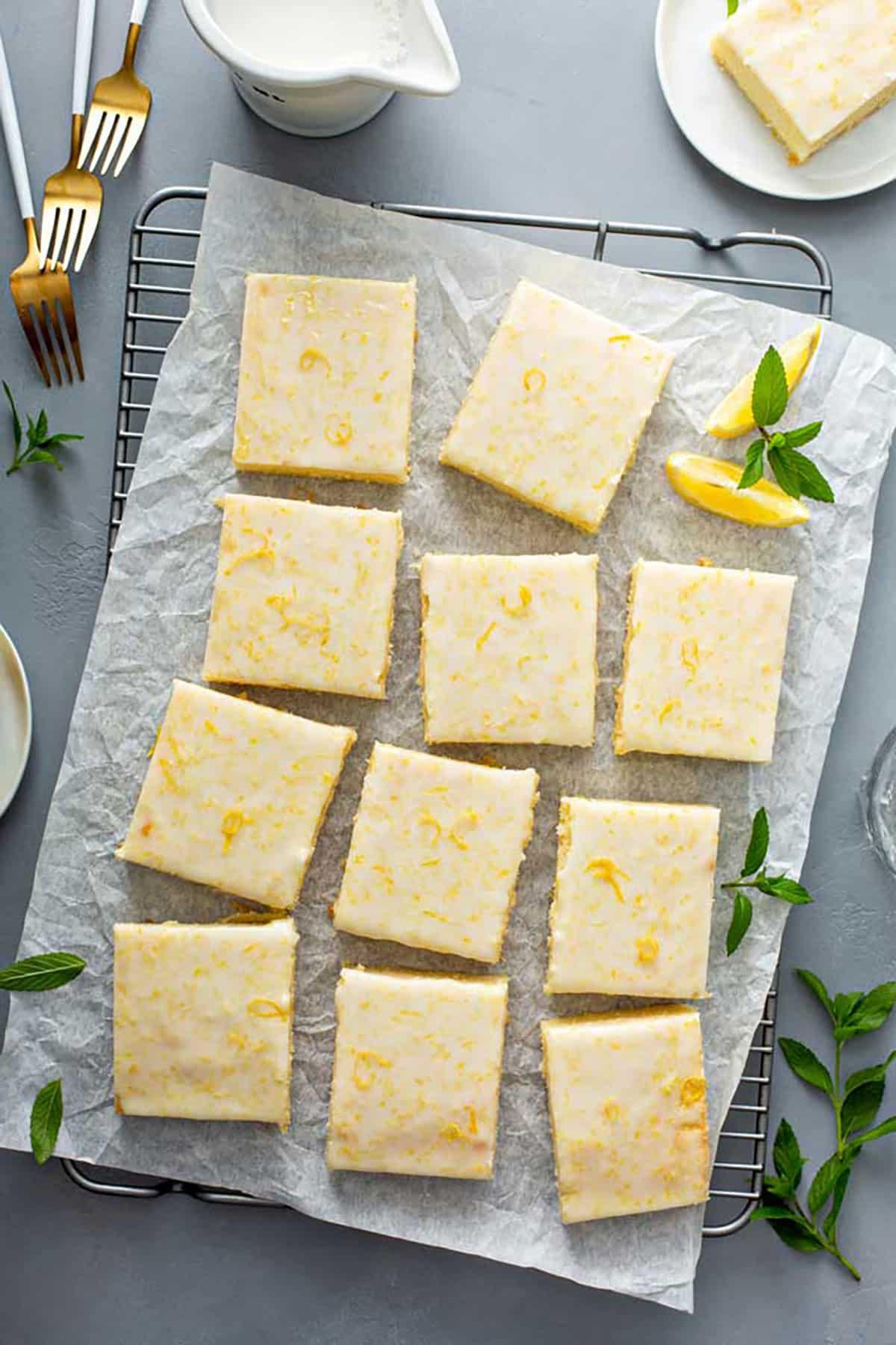 Cut up glazed lemon brownies on a cooling rack