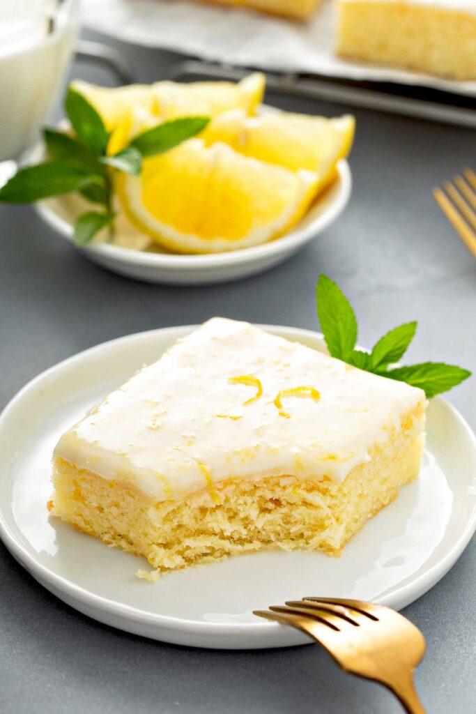 a glazed Lemon Blondie bar on a plate