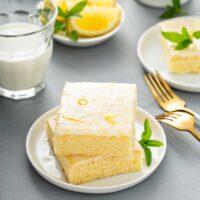A stack of lemon brownies with lemon glaze
