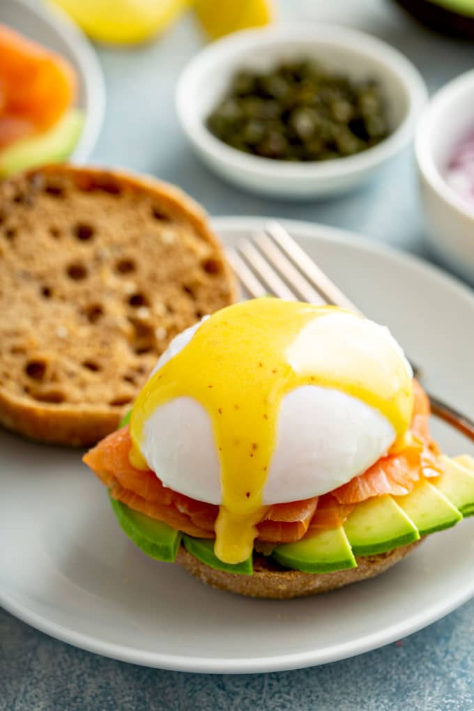 Eggs Benedict with smoked salmon, Hollandaise and avocado