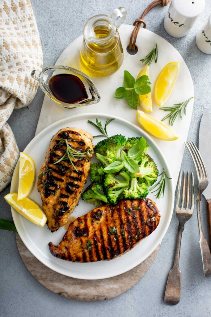 Grilled Chicken Breast - Lemon Blossoms: Top view of grilled chicken on a plate.