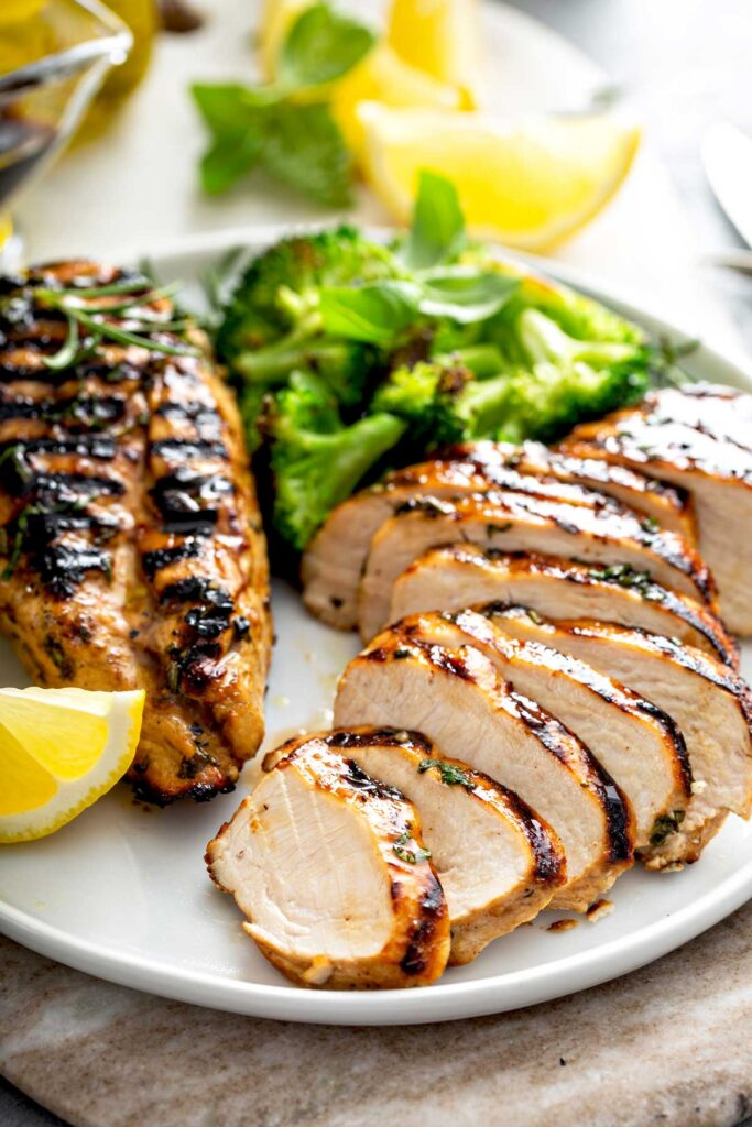 Grilled Chicken Breast - Lemon Blossoms: Sliced chicken from the grill on a white plate.