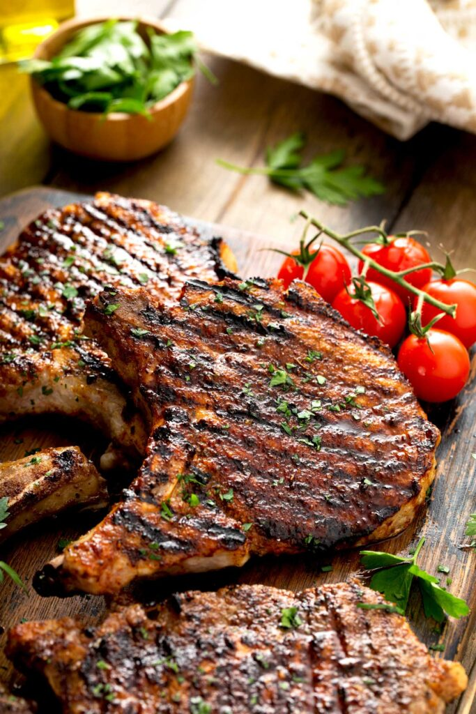 Pork chops from the grill on a wooden board