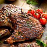 Grilled pork chop on a wooden board