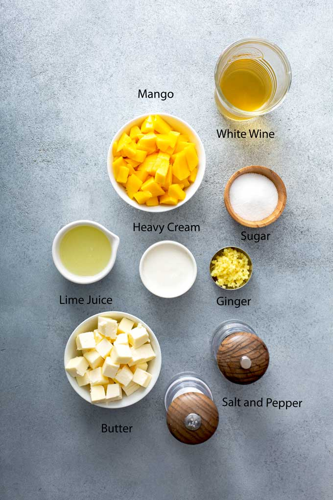 Ingredients to make mango butter wine sauce or mango lime beurre blanc