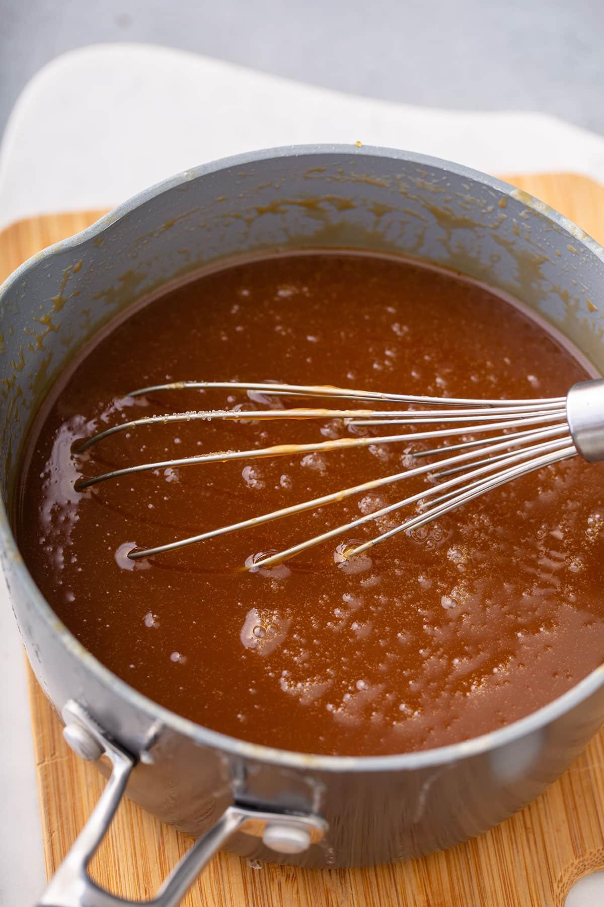 Caramel sauce in a saucepan.