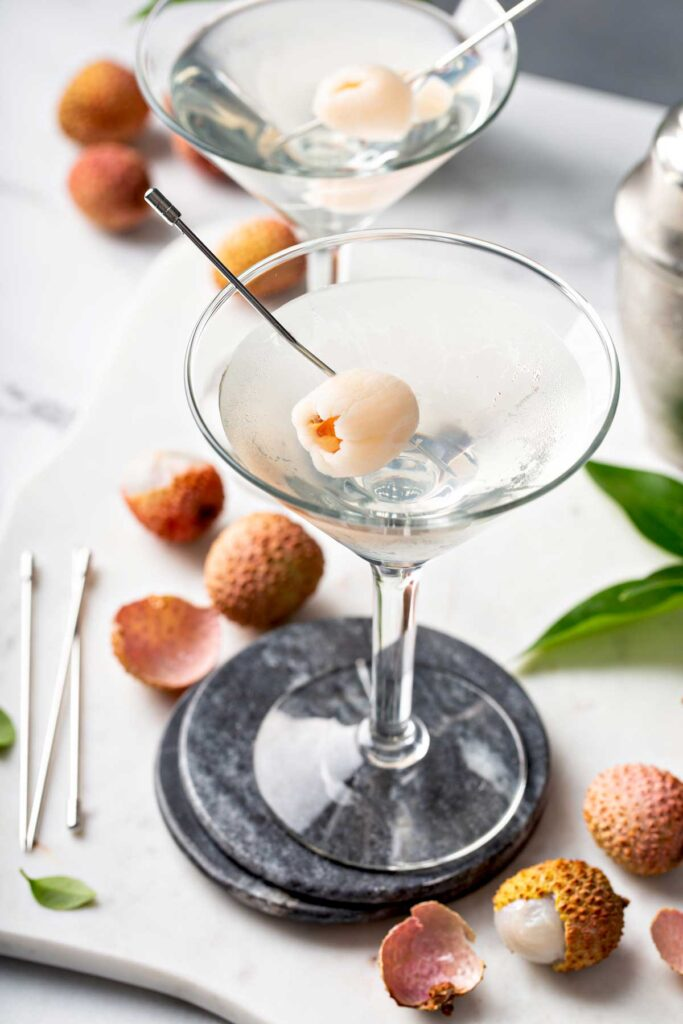 Refreshing and fruity martini with lychee on a pick