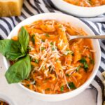 A bowl of penne pasta with vodka sauce