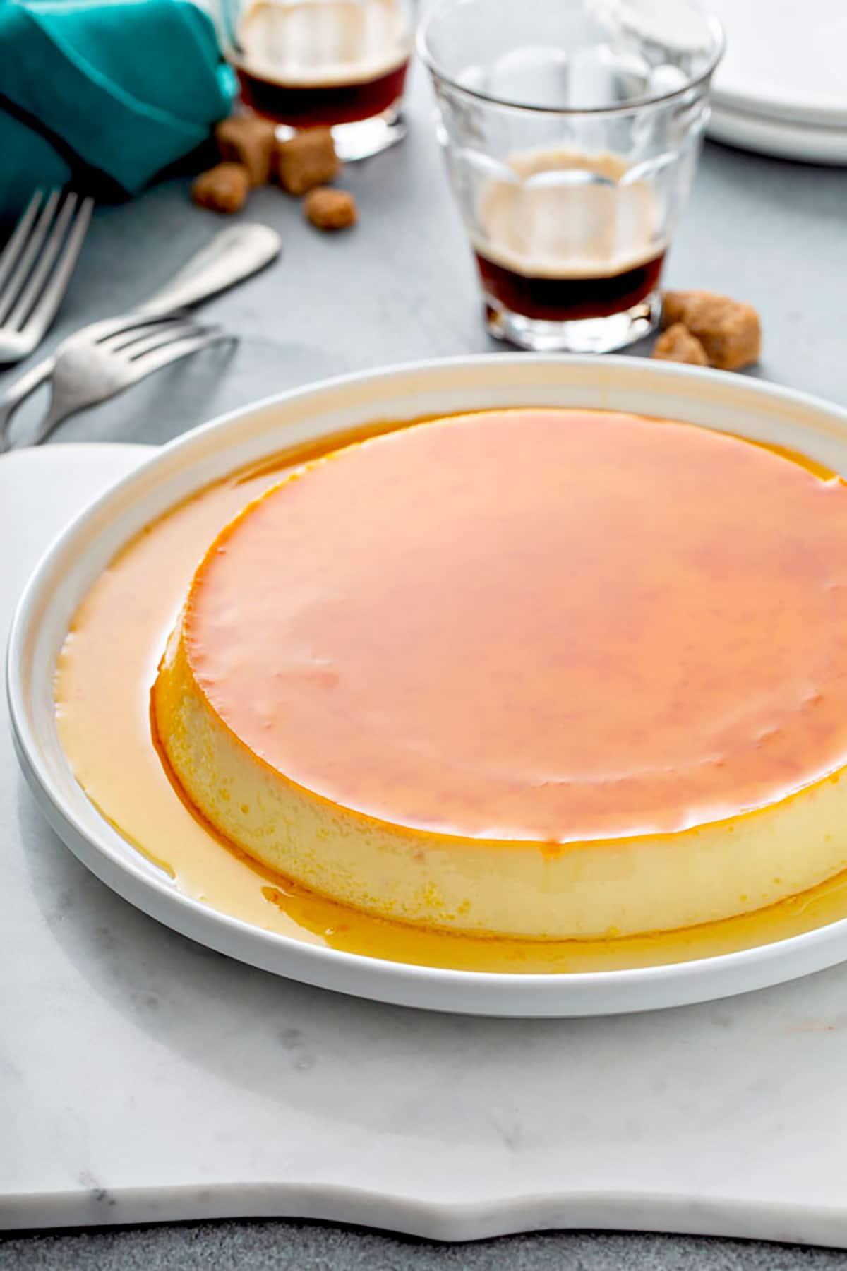 Creme Caramel or caramel flan with golden caramel on a white plate
