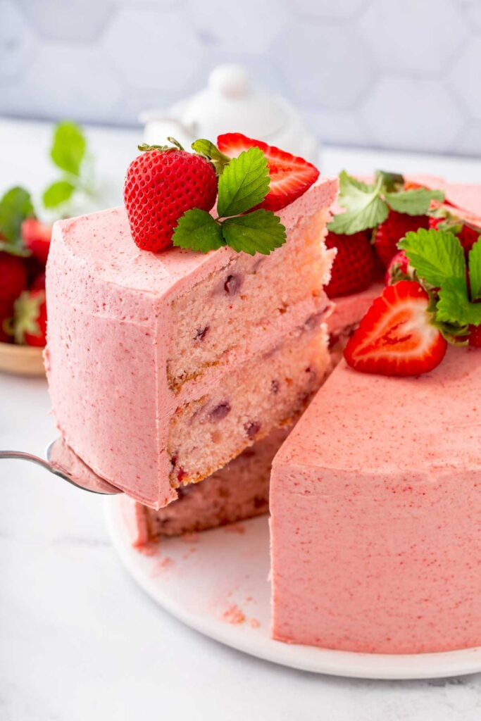 Serving a slice of light and fluffy fresh strawberry cake.