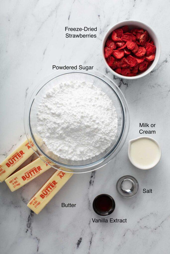 Ingredients to make strawberry frosting (fresh strawberry buttercream)