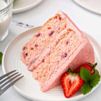 A slice of fresh strawberry cake with buttercream