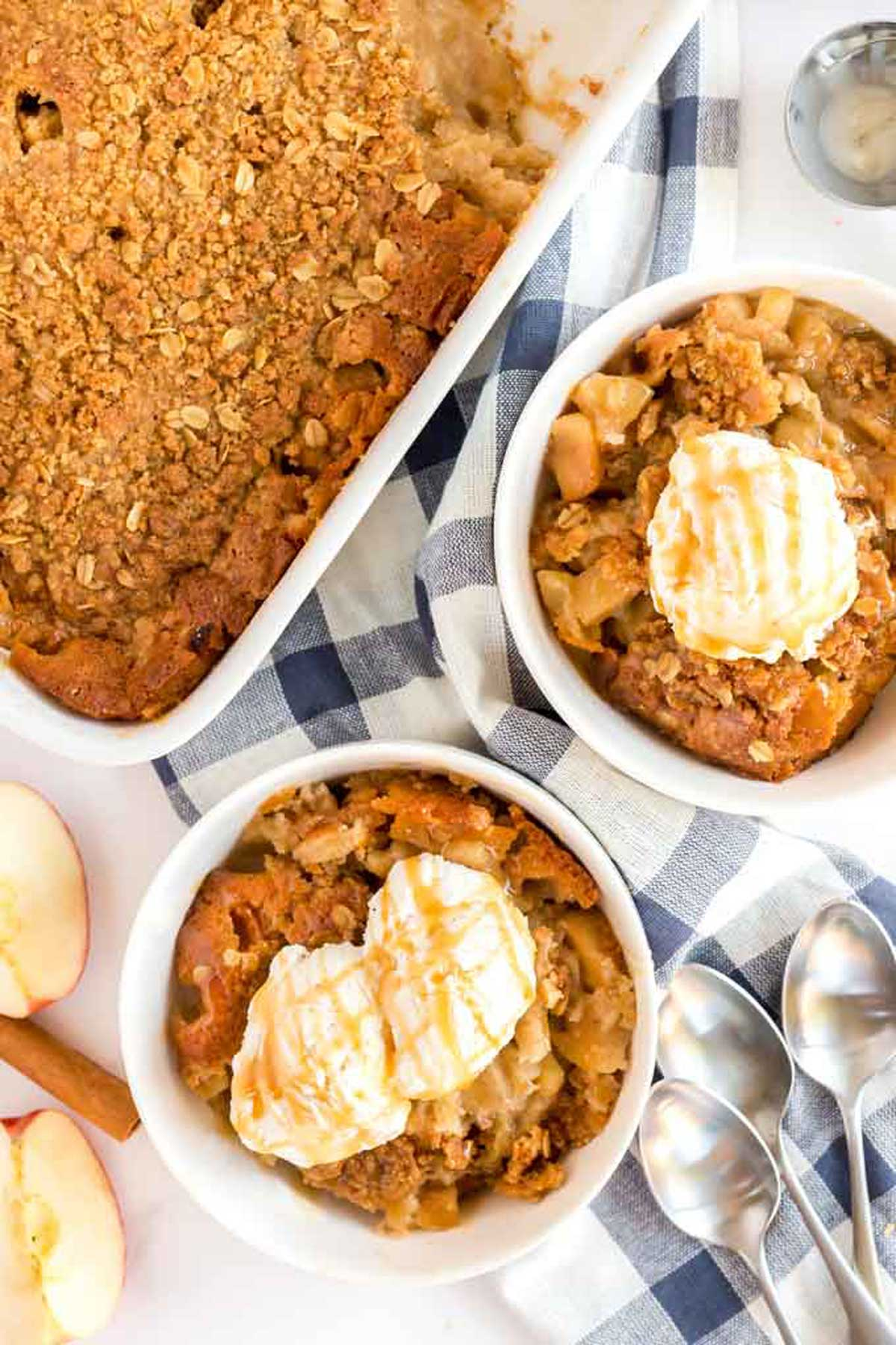 Bowls of apple crisp topped with vanilla ice cream