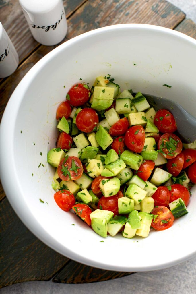 Chopped vegetable salad in a white bowl