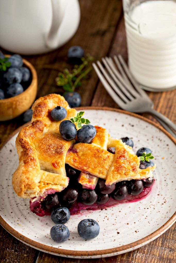 Serving of fresh blueberry pie recipe on a plate