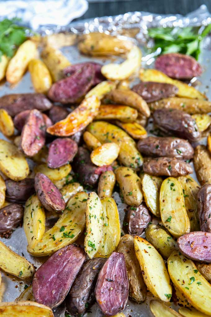 Crispy and tender roasted potatoes on a sheet pan.