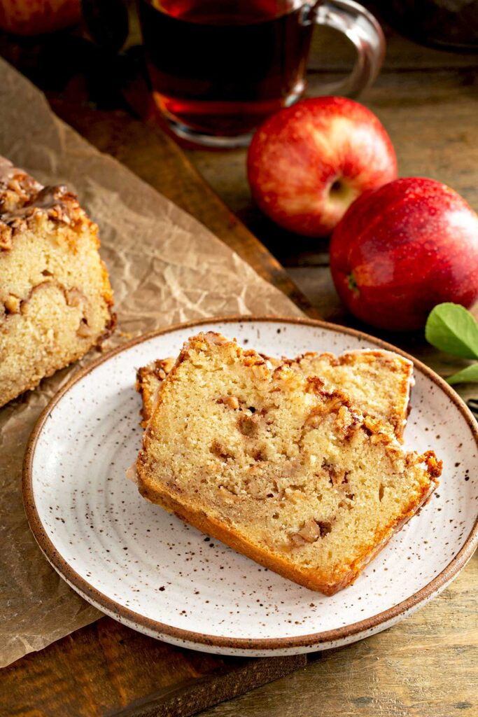 Two slices of apple bread on a white plate