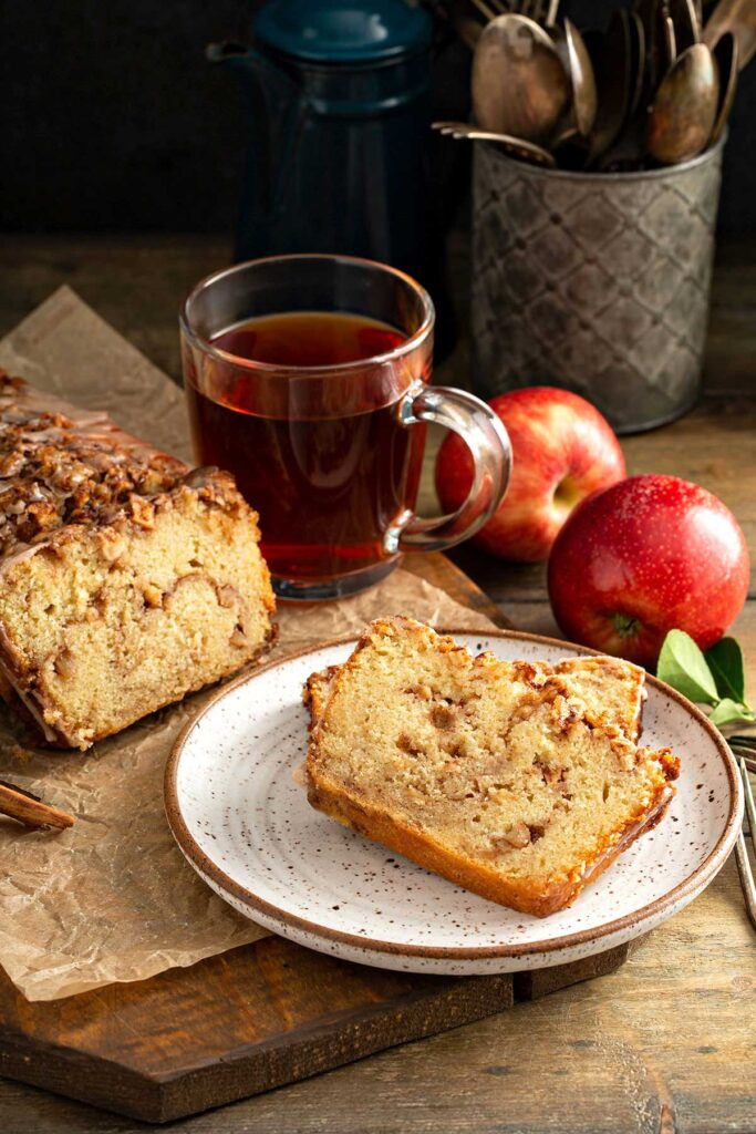 slices of warm cinnamon apple bread served on a white plate