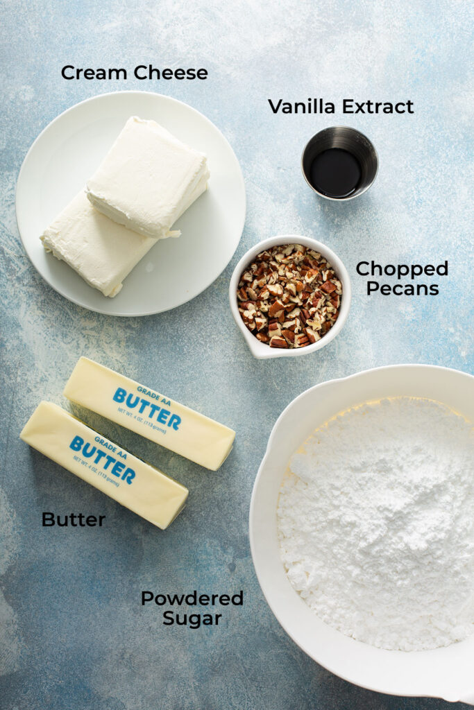 Ingredients to make the cake's rich and smooth cream cheese frosting plus additional chopped pecans to decorate the cake..