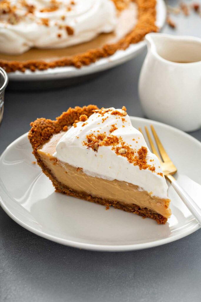 slice of butterscotch pie topped with whipped topping