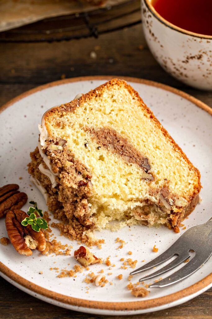Sliced of the best coffee cake on a white plate