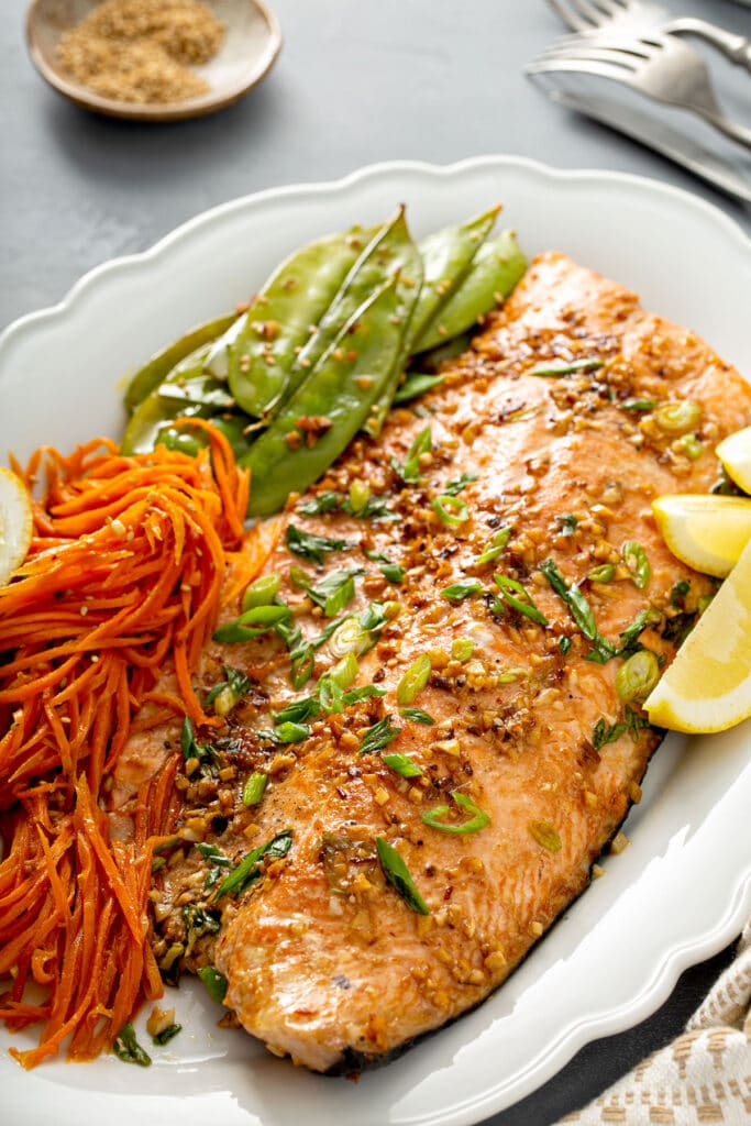 Perfectly baked salmon with carrots smothered in Asian butter