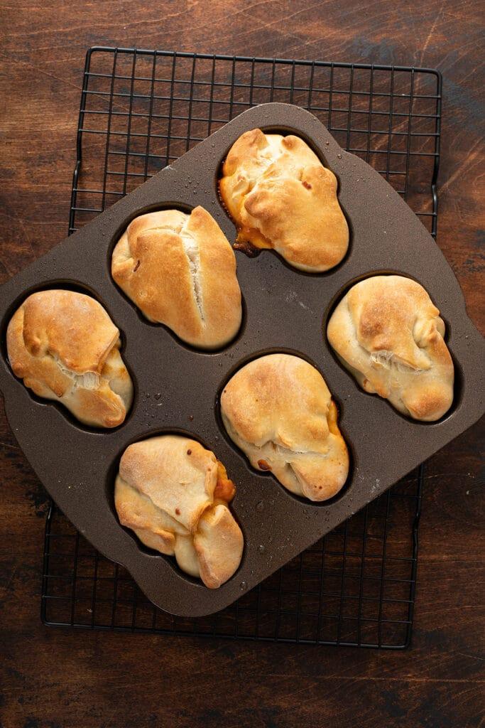 Baked pizza skulls in baking pan