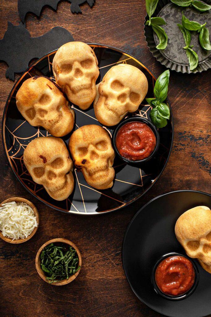 Pizza skulls on a plate with marinara sauce